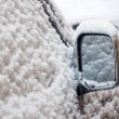 Car wing mirror in snow — Stock Photo