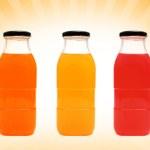 Glass bottles of juice — Stock Photo