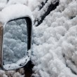 Car wing mirror in snow — Stock Photo #8972976