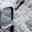 Car wing mirror in snow - Stock Photo