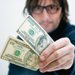 Royalty-Free Stock Photo: Man paying in dollars