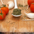 Oregano, garlic and red cherry tomato - Stock Photo