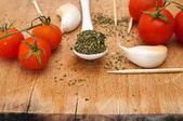 Oregano, garlic and red cherry tomato — Stock Photo