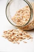 Oat flakes in jar — Stock Photo
