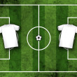 Football or soccer field with blank white shirts — Stock Photo
