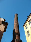 Brick chimney in the yard — Stock Photo