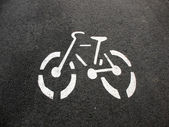 Designation of a bicycle path on the pavement — Stock Photo