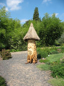 Ecorative figure of a gnome-Treefolk in the Botanical Garden in Prague — Stock Photo