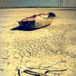 Boat in the desert - Stock Photo