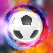 Soccer ball on color rings background — Stock Photo