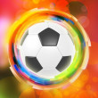 Soccer ball on color rings background — Stock Photo #10464505