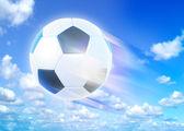 Goal. a soccer ball over blue sky background — Stock Photo