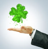 St. Paricks day symbol on businessman hend — Stock Photo