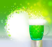 Green beer for St Patrick day on a green background — Stock Photo