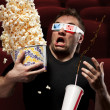Stock Photo: Very scared mwatching 3D movie