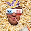 Stock Photo: Face in popcorn watching 3D movie