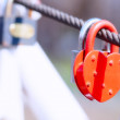 Heart shape padlock on bridge railing — Stock Photo