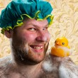 Happy man with duck toy — Stock Photo