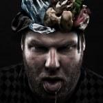 Heap of garbage inside silly man head — Stock Photo