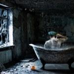 Alone man in abandoned bathroom — Stock Photo