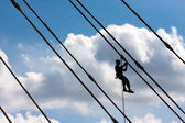 Silhouette of construction climber — Stock Photo