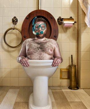 Bizarre man in vintage toilet