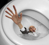 Businessman sinking in toilet bowl — Stock Photo