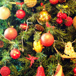 Stock Photo: Christmas ornaments on a tree