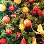 Christmas ornaments on a tree — Stock Photo