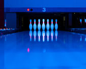 Ten bowling pins at the end of alley — Stock Photo