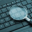 Magnifying glass on laptop — Stock Photo #9538043