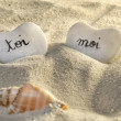 Royalty-Free Stock Photo: French you and me hearts of pebbles in the sand