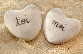 French you and me hearts of pebbles in the sand — Stock Photo