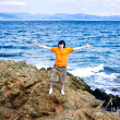 The young man at the sea on a stone — Stock Photo #9766471