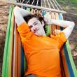 Stock Photo: The young man has a rest in a hammock