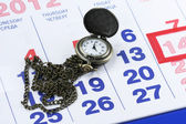 Hours per a case on a chain on a calendar — Stock Photo