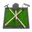 Foto Stock: Gardening Tools on Bed of Raised Grass