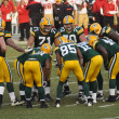 Green Bay Packers Huddling - Stockfoto