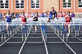 High school boys hurdles race — Stock Photo