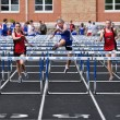 Teen Girls Competing in High School Hurdles Race — Stock Photo #8388553