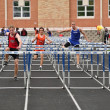 Stock Photo: Teen Boys Competing in High School Hurdles Race