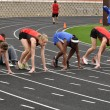 Stock Photo: Teen Girls in Starting Blocks at High School Sprint Race