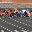 Stock Photo: Teen Boys in Starting Blocks at High School Sprint Race