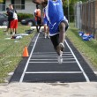 Teen Boy Doing the Long Jump at a High School Track and Field Meet — Stock Photo