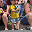 Young Boy Eating a Frozen Treat While Watching Parade — Stock Photo