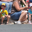 Young Boy and Girl Eating Frozen Treats While Watching Parade — Stock Photo