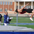 Teen Boy Doing the High Jump at a High School Track and Field Meet — Stock Photo #8388779