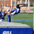 Teen Boy Doing the High Jump at a High School Track and Field Meet — Stock Photo #8388780