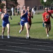 Stock Photo: Teen Girls Competing in Long Distance High School Track Meet Race