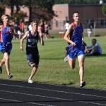 Teen Boys Running in a Long Distance High School Track Meet Race — Stock Photo #8388874